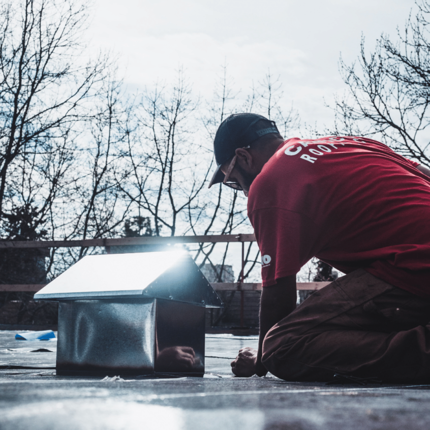 image of Canuck roofer installing flashing on flat roof